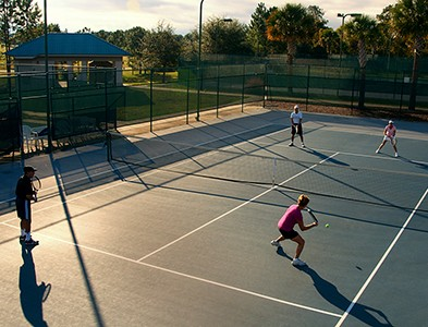 Tennis courts and players at On Top of the World Communities in Ocala, Florida