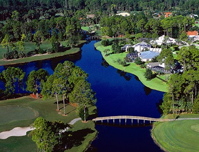 Aerial water, golf course and homes at Plantation Bay Golf and Country Club in Ormand Beach, Florida