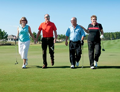 Foursome couples golfing on golf course at On Top of the World Communities in Ocala, Florida