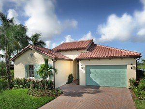 House exterior and garage at Minto PortoSol in Royal Palm Beach, Florida
