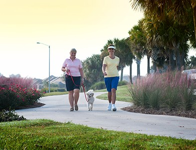 Women walking on trails at On Top of the World Communities in Ocala, Florida