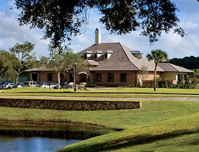 Golf course, pond and clubhouse at Plantation Bay Golf and Country Club