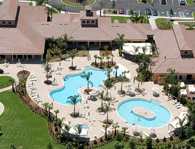 Swimming pool and clubhouse at Del Webb Southshore Falls in Apollo Beach Florida