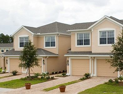 Sweetwater by Del Webb – Florida 55+ Communities - Townhouse exteriors at Sweetwater by Del Webb in Jacksonville, Florida