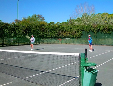 Women playing tennis at courts at Plantation Bay Golf and Country Club