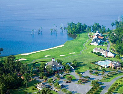 Aerial waterfront golf course and clubhouse at Albemarle Plantation in Hertford, North Carolina