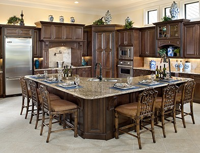 Minto at TwinEagles – Florida Coastal Communities - House interior kitchen and island at TwinEagles in Naples, Florida