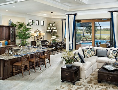 Minto at TwinEagles – Florida Coastal Communities - House interior kitchen, living and dining room at TwinEagles in Naples, Florida
