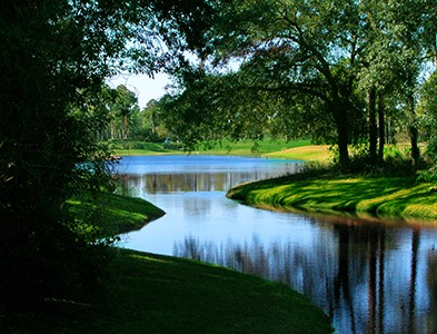 Waterfront canal and pond at Plantation Bay Golf and Country Club