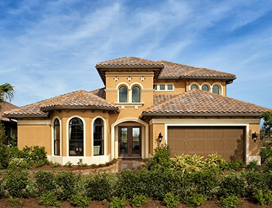 Minto at TwinEagles – Florida Coastal Communities - Stucco two story house exterior at TwinEagles in Naples, Florida