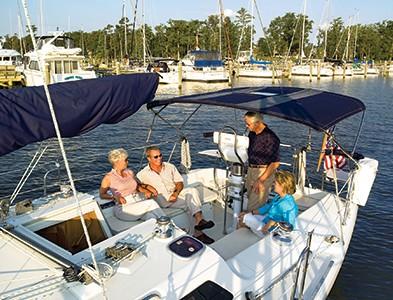 Couples on sail boat at marina dock at Albemarle Plantation in Hertford, North Carolina