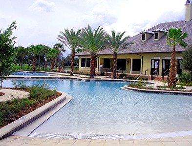 Swimming pool and clubhouse at Plantation Bay Golf and Country Club