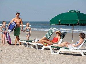 Family on the beach at Amelia Island Plantation in Florida