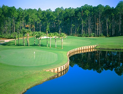 Golf course, green and water feature at Plantation Bay Golf and Country Club