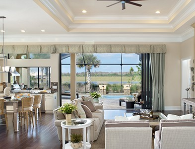 Minto at TwinEagles – Florida Coastal Communities - House interior living and dining room and patio at TwinEagles in Naples, Florida