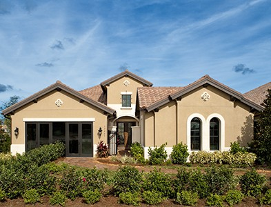 Minto at TwinEagles – Florida Coastal Communities - Single story stucco house exterior at TwinEagles in Naples, Florida