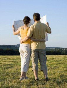 Couple with map in a meadow