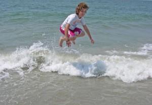 kids playing the waves, beach fun