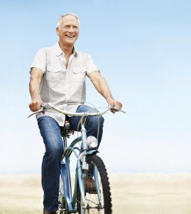 Happy mature man rides his bicycle-copyspace