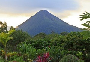 A lush garden in La Fortuna, Costa Rica with Arenal Volcano in the background